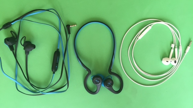 L to R: SMS Audio BioSport, Plantronics BackBeat Fit, Apple Headphones
